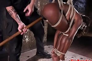 Submissive ebony disciplined with sextoys