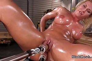 Big tits oiled Milf bangs machine